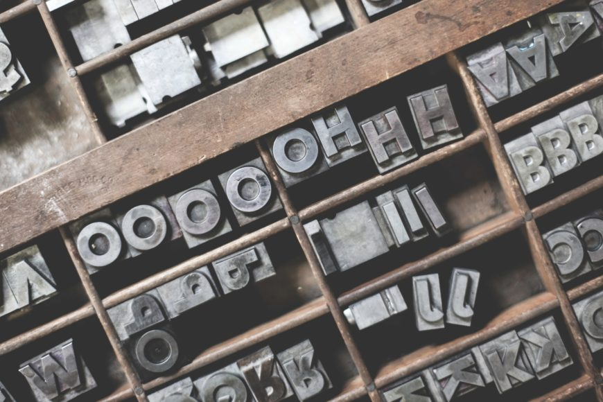 Printing press preparing typography