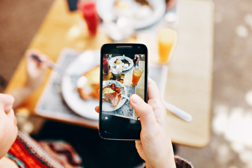 Influencer taking picture of their food for Instagram