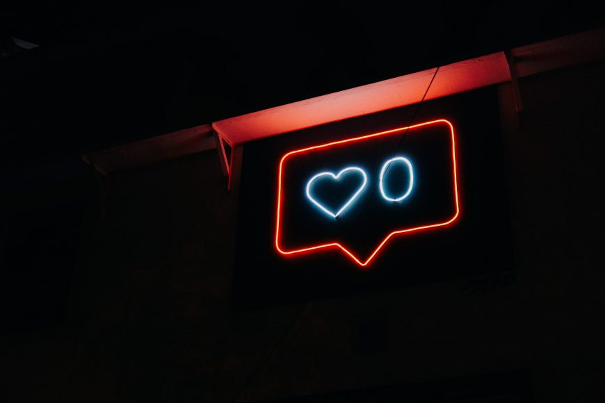 A neon sign illustrating Instagram's like function