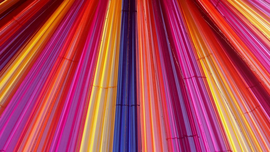 Coloured strips of plastic lined up next to each other to form an eye-catching screen.